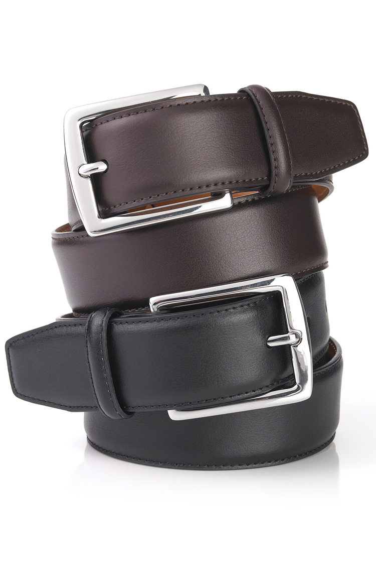 Traditional formal wear, like tuxedos, forgo belts, but if the suit you're wearing has trousers with belt loops and requires something dressy, a black leather belt with a simple silver buckle.